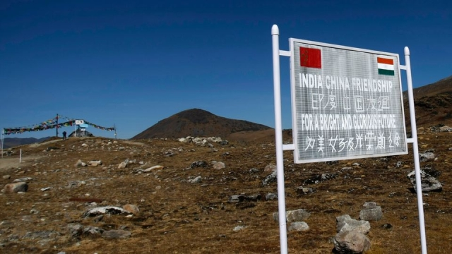A signboard seen from the Indian side of the Indo-China border. (Photo: Reuters)