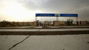A dog walks past the main entrance of the Jaisalmer Airport. (Photo: Reuters)
