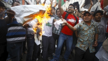 On September 21, supporters of opposition parties burnt papers symbolising Nepal's first democratic Constitution during a protest in Kathmandu. (Photo: Reuters)