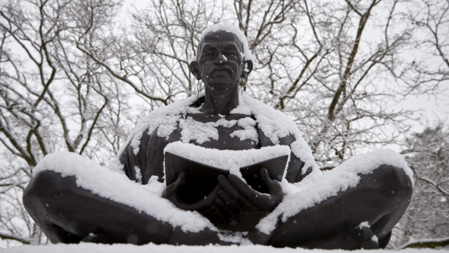 Snow falls on a statue of Mahatma Gandhi on a winter morning in Geneva. (Photo: Reuters)