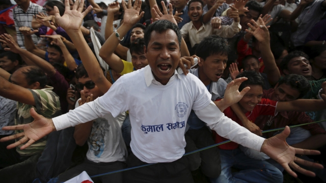 September 21: People cheer as they gather during a celebration, a day after the first democratic Constitution was announced in Kathmandu. (Photo: Reuters)