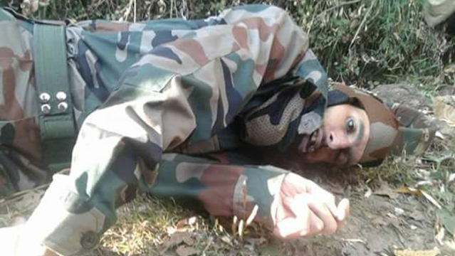 Fayaz Ahmed Bhat's body in a paddy field in Tangmarg, J&K.