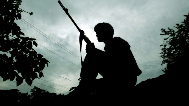 A Naga rebel stands guard. (Photo: Reuters)