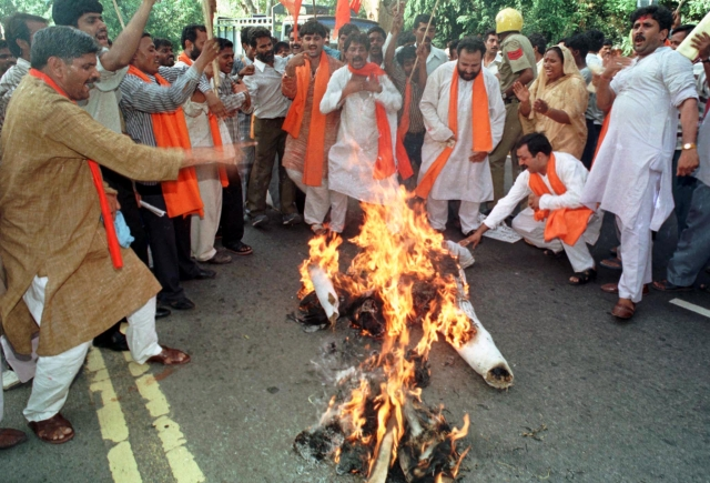 "Shiv Sena activists burn an effigy of veteran Bollywood star Dilip Kumar in New Delhi on July 13, 1999. More than 50 activists of the Shiv Sena party demonstrated in front of a hotel where Kumar is staying and asked him to return the ""Nishan-E-Imtiaz"", the highest civilian award by Pakistan. (Photo: Reuters)"