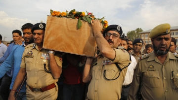 Police officers carry the coffin of their colleague Altaf Ahmed during the wreath-laying ceremony in Srinagar. (Photo: AP)