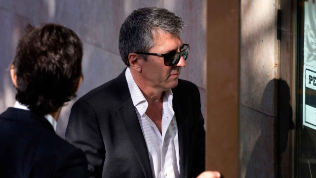 In this Sept. 27, 2013 file photo, Lionel Messi's father Jorge Horacio Messi, arrives at a court to answer questions in a tax fraud case in Gava, near Barcelona. (Photo: AP)