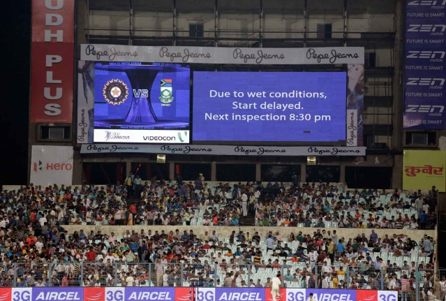 The official announcement for yet another delay in start of play is made on an electronic board in Kolkata. (Photo: AP)