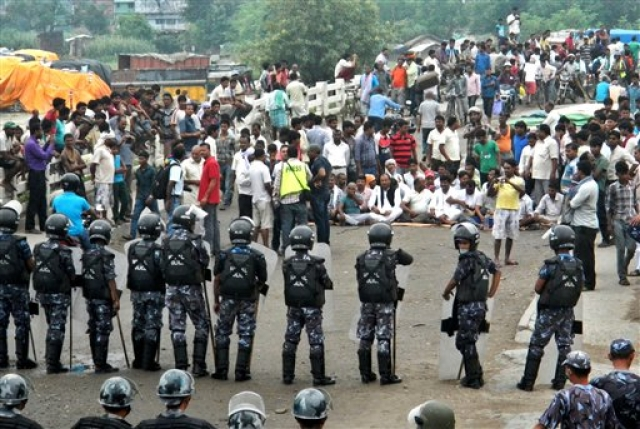 Nepal's border districts had for months witnessed low-level violence by the Madhesi community when the draft Constitution was being debated, and hours after it was passed on September 20,  violence escalated. (Photo: AP)
