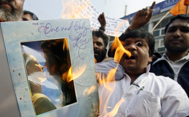Shiv Sena activists shout slogans and burn Valentine's Day cards during a protest in New Delhi on February 14, 2007. Hardline Hindu activists protested against celebrations of St Valentine's Day in the Indian capital on Wednesday, calling them immoral and a corruption of the country's ancient civilisation. (Photo: Reuters)