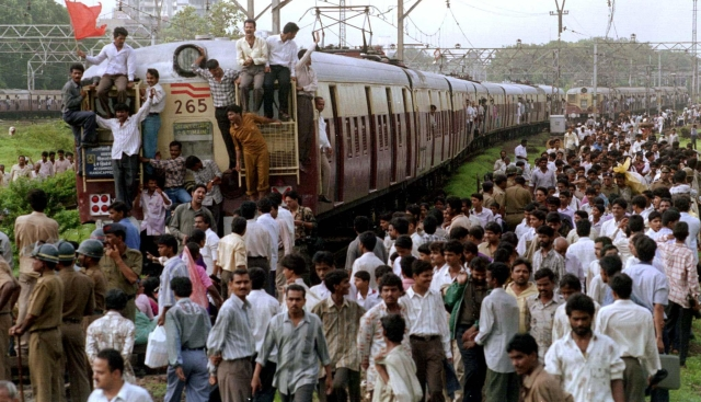 Shiv Sena party workers stopped suburban trains in Mumbai on July 10, 1997, to highlight their demand for apprentices who have been working with the Indian Railways since 1990 be given permanent jobs. (Photo: Reuters)