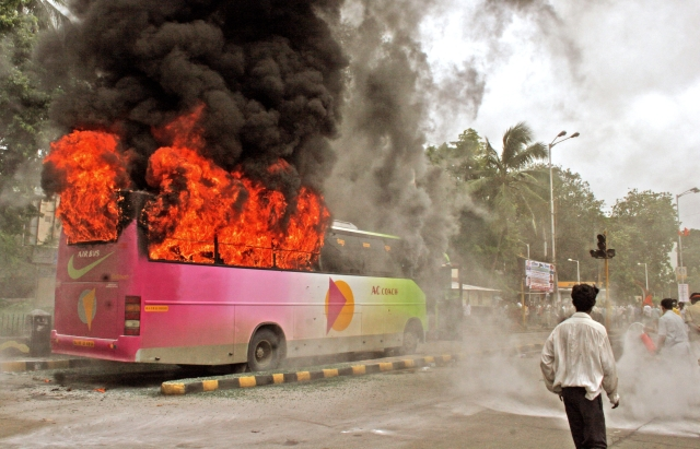 Members of Shiv Sena party pelt buses with stones, shut shops and block sections of a major highway in Mumbai on July 9, 2006 after a statue of the party leader's wife was defaced. (Photo: Reuters)