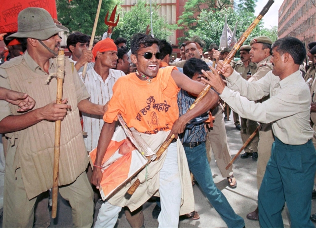 Policemen hold back activists of Shiv Sena during a protest in New Delhi on July 31, 1999. More than 100 activists protested against an order by Election Commission disenfranchising its chief, Bal Thackeray, for six years for making inflammatory public speeches. (Photo: Reuters)
