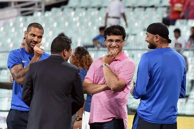 Sourav Ganguly, Shikhar Dhawan and Harbhajan Singh before the start of T20 match. (Photo: PTI)
