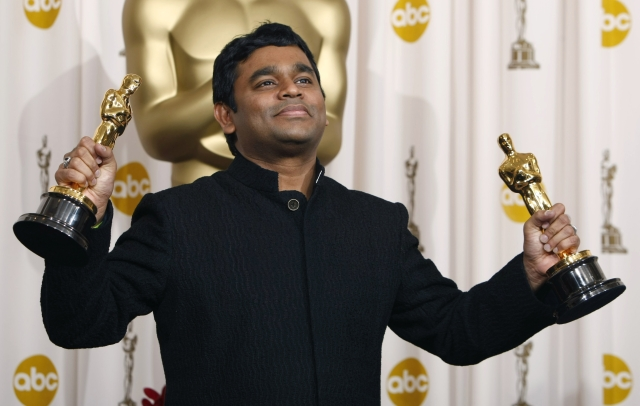 """Composer A.R. Rahman displays his Oscars (original song and original score) for his work on the film """"Slumdog Millionaire"""" at the 81st Academy Awards in Hollywood, California, in February 2009. (Photo: Reuters)"""