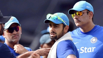 Indian Captain MS Dhoni, Virat Kohli and Team Director Ravi Shastri during a training session at Eden Garden in Kolkata on Wednesday. (Photo: PTI)