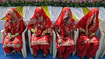 Muslim brides wait for the start of a mass marriage ceremony in Ahmedabad. (Photo: Reuters)