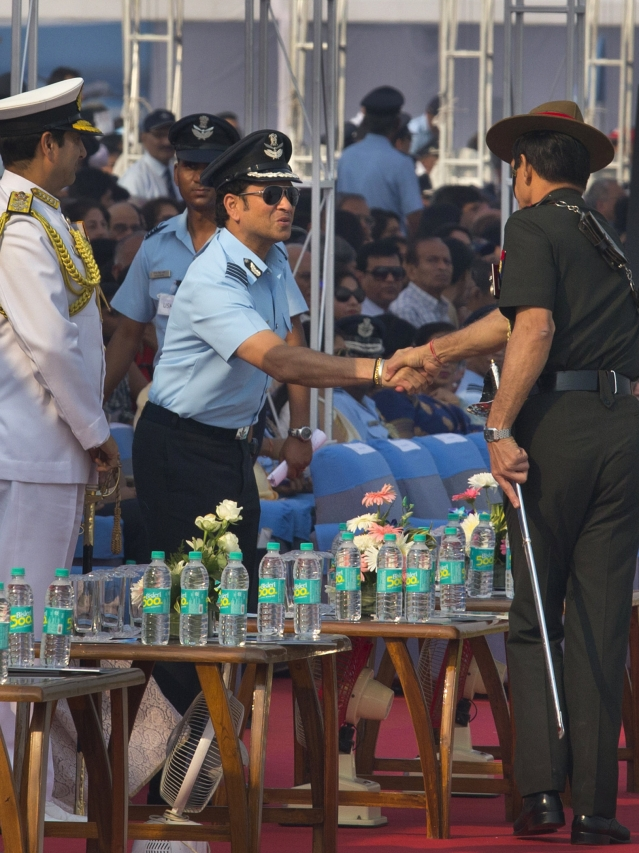 Former Indian cricketer and honorary Indian Air Force officer Sachin Tendulkar, second left, shakes hand with Indian Army Chief Dalbir Singh Suhag. (Photo: AP)