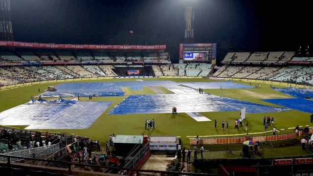 Covers in place at the Eden Gardens as it rains before the start of the3rd T20. (Photo: PTI)