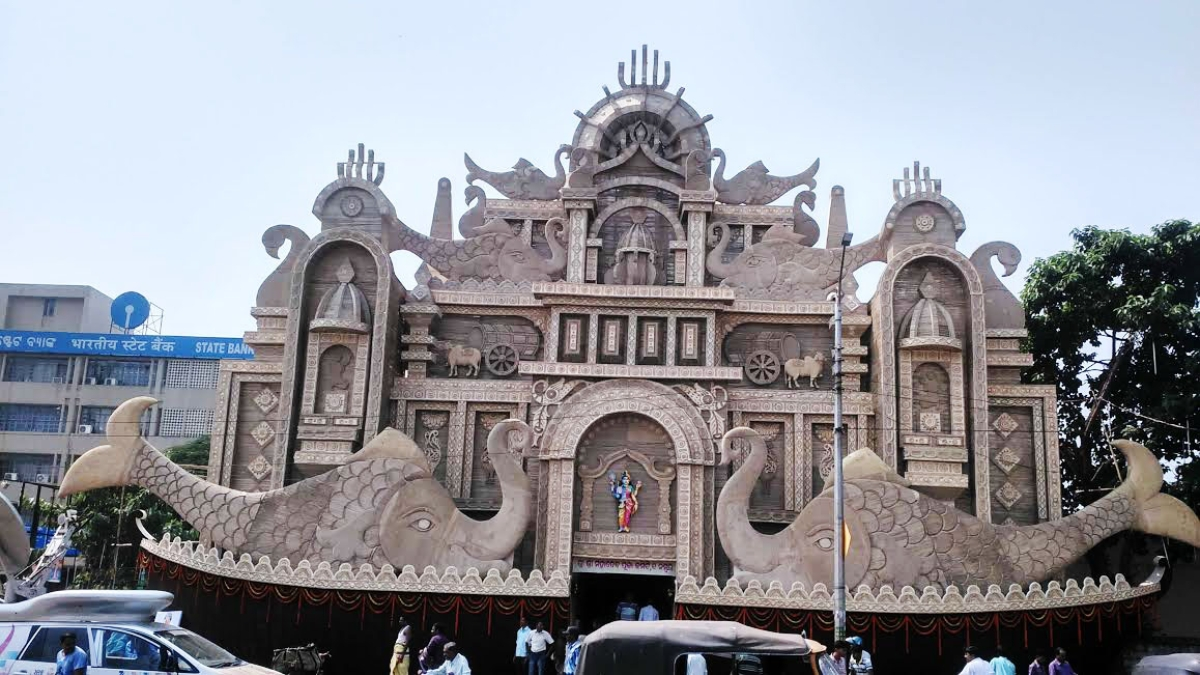 In pictures durga puja celebrations beyond kolkata the quint 65 ft tall durga pujanbsppandal gate made out of jute and sand designed thecheapjerseys Images