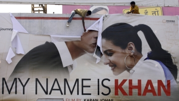"Supporters of Shiv Sena tear a poster of Bollywood actor Shah Rukh Khan's new film ""My Name is Khan"" during a protest in Ahmedabad on February 12, 2010. (Photo: Reuters)"