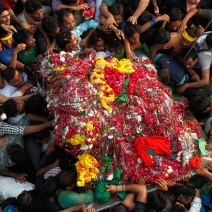 "Shi'ite Muslims carry a ""Tazia"", or a replica of the coffin of Imam Hussein, during a Muharram procession to mark Ashura in Allahabad."