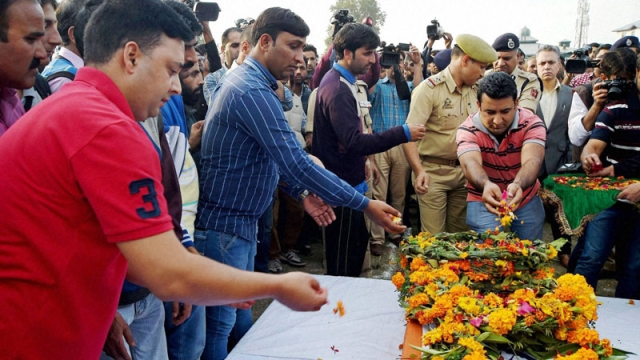 People pay respect to the mortal remains of Sub-Inspector Altaf Ahmad. (Photo: PTI)