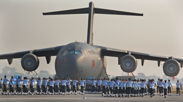 Indian Air Force soldiers march past the IAF C-17 Globemaster during the Air Force Day parade at Hindon Air Force base near New Delhi. (Photo: AP)
