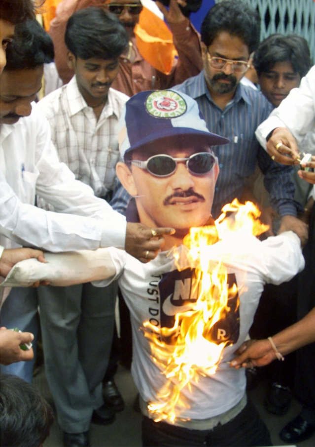 Members of Shiv Sena had set fire to an effigy of former Indian cricket captain Mohammad Azharuddin in Mumbai on November 3, 2000, after he was accused by the Central Bureau of Investigation of fixing cricket matches. (Photo: Reuters)