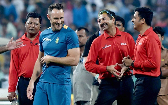 South African captain Faf du Plessis shares a light moment with umpires during ground inspection for 3rd T20 Match at Eden Gardens. (Photo: PTI)