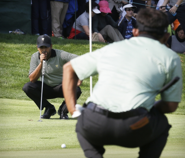 Anirban Lahiri lines up a putt on the first hole  during their foursome match at the Presidents Cup. (Photo: AP)