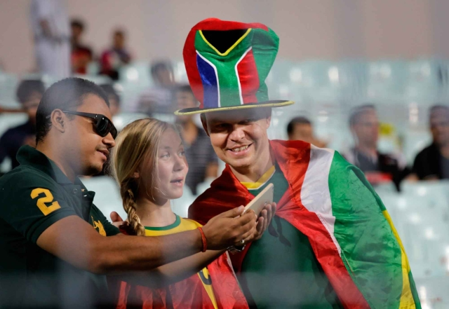 The Proteas' fans take a selfie while waiting for the umpires' next inspection. (Photo: AP)