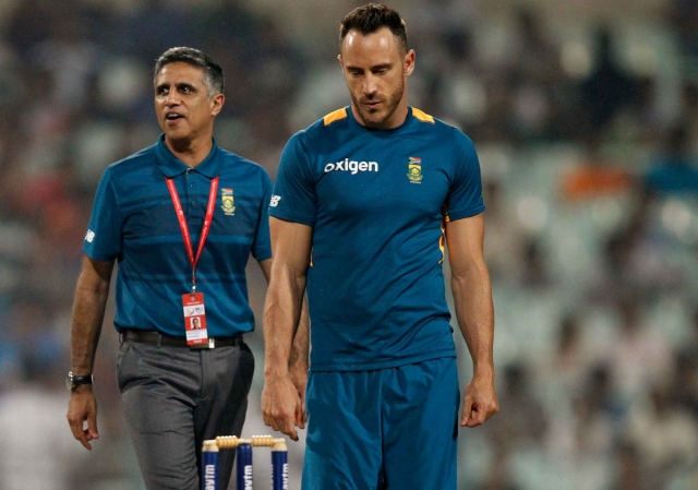 South Africa's captain Faf du Plessis walks back into the middle to inspect the pitch. (Photo: AP)