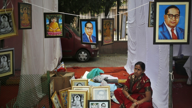 A vendor sells portraits of BR Ambedkar on a pavement in New Delhi. (Photo: Reuters)