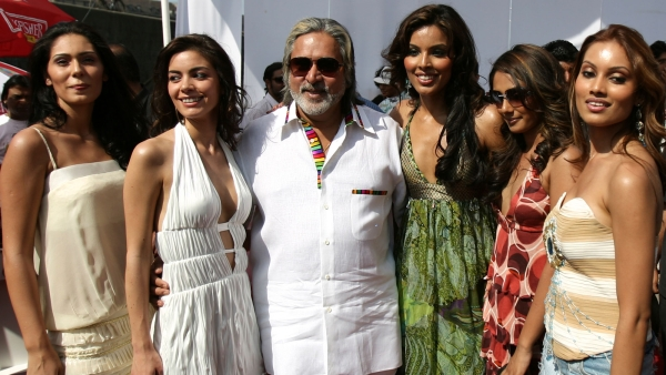 Vijay Mallya (C) poses with models featured in Kingfisher's Swimsuit Special 2007 calendar at a function in Mumbai. (Photo: Reuters)