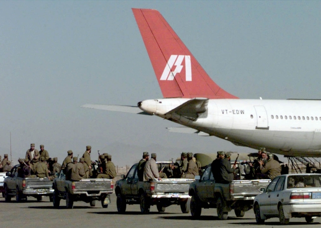 Armed Taliban forces take position near the IC-814 at Kandahar airport.