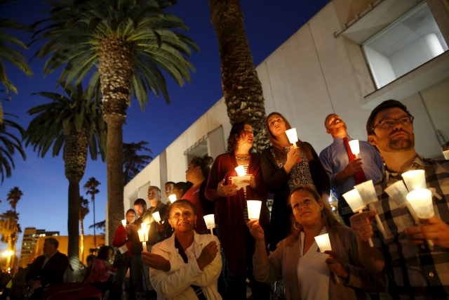 People hold candles during a vigil in  San Bernardino, California. (Photo: Reuters)