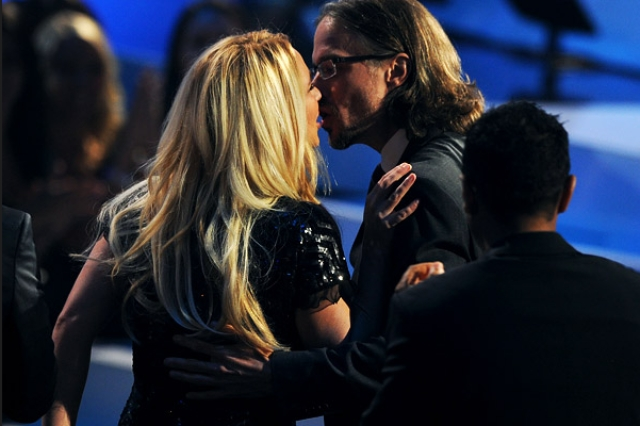 Britney Spears kisses Jason Trawick at the VMAs held in 2011