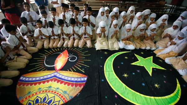 Hindu and Muslim school children offer prayers for peace inside their school in Ahmedabad.