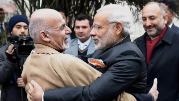 File image. Prime Minister Narendra Modi and Afghan President Ashraf Ghani hug each other during a welcome ceremony at President Palace in Kabul. (Photo: PTI)