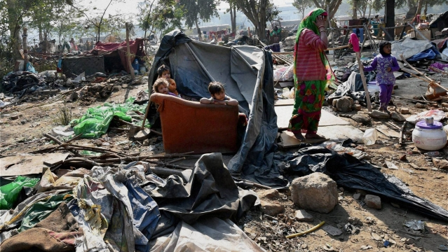 An affected family at Shakur Basti where a demolition drive was carried out in a slum, in New Delhi, December 14, 2015. (Photo: PTI)