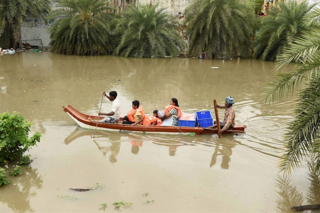 Photo of fishermen helping people commute on December 3, 2015. (Photo: PTI)