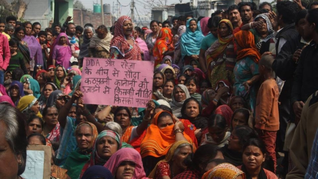 "Residents of Kathputli colony, a slum in West Delhi, protest against eviction, February 2014. (Photo courtesy: <a href=""https://www.facebook.com/Friends-of-Kathputli-Colony-Delhi-604606192938523/?fref=photo"">Friends of Kathputli Colony Delhi</a>/Facebook)"