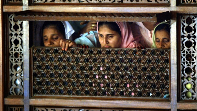 Muslim women inside a mosque watch proceedings of a mass wedding organised by the Dawoodi Bohra Muslim sect in Bombay. (Photo: Reuters)