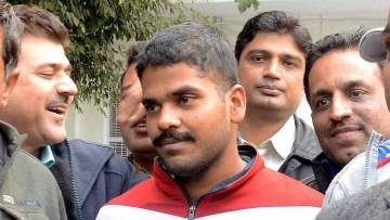 Dismissed Air Force official Ranjith (C) who has been arrested for allegedly sharing secret documents with intelligence operatives backed by Pakistan's ISI, at the Special Cell of the Delhi Police in New Delhi on Tuesday. (Photo: PTI)