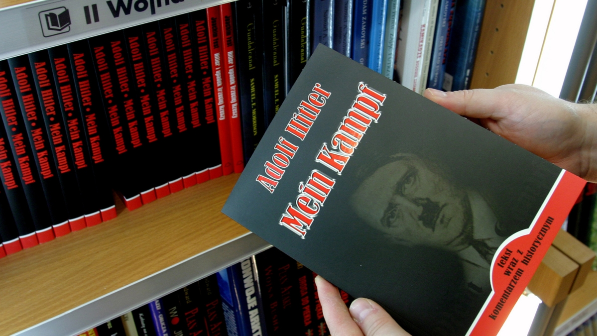 A customer holds a copy of Adolf Hitler's <i>Mein Kampf</i>.