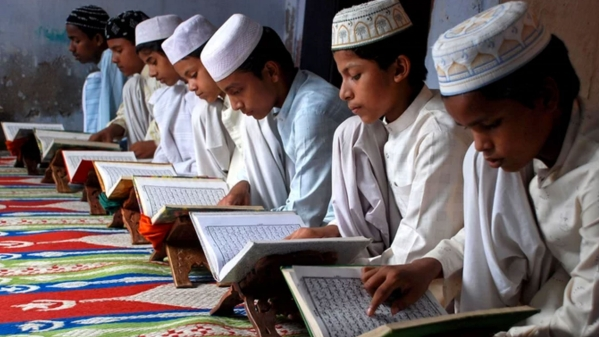 Children read the Koran at a madarsa on the first day of the holy month of Ramadan. (Photo: Reuters)