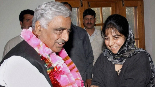 File photo of Mufti Mohammad Sayeed with his daughter Mehbooba Mufti during a meeting in Srinagar in October 2002. (Photo: PTI)