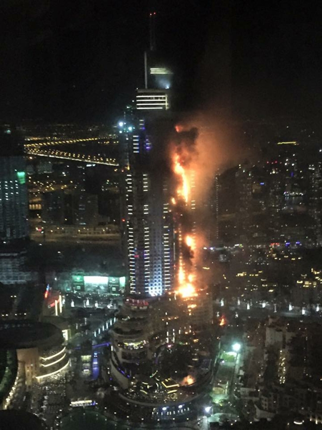 A massive fire engulfs the exclusive Address Downtown in Dubai. (Photo: AP)