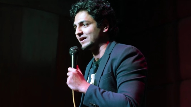 A still from one of Kenny Sebastian's standup comedy videos.