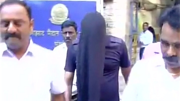 Sayyed Abbas Tublani taken away by Mumbai police. (Photo: ANI)